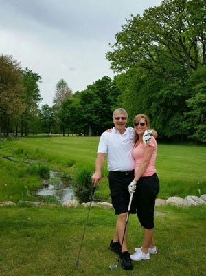 Tony and Janet Blundy stand near the tee boxes of the No. 16 hole at Ledge Meadows Golf Course in Grand Ledge, where the husband and wife made consecutive holes-in-one shots on Sunday afternoon.