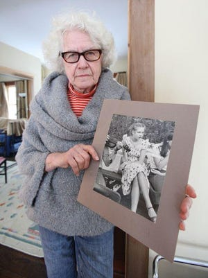 Lois Bohovesky is pictured in this file photo with a picture of her slain daughter Paula.