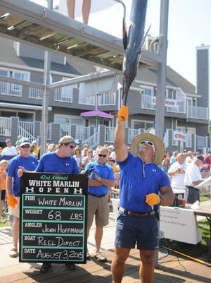 Alex Davis weighs the first white marlin of the 42nd White Marlin Open at Harbour Island in Ocean City.