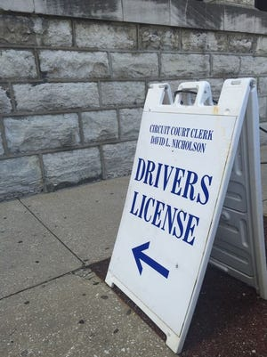 Signage directs patrons to the downtown driver's license branch at 514 W. Liberty St. The location, along with others across the state, experienced computer failure Thursday.