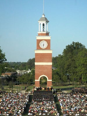 Union University students gather for graduation ceremonies in front of Miller Tower on the Great Lawn in this file photo.