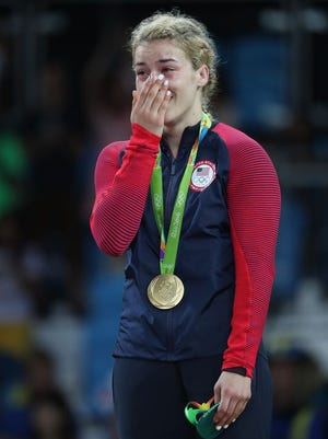 Helen Louise celebrates after winning a gold medal.