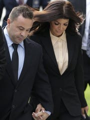 Joe and Teresa Giudice appear outside a Newark courthouse in 2014.