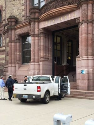The scene on Thursday after William Jackson tried to drive through City Hall after years of frustration over zoning and building permits.