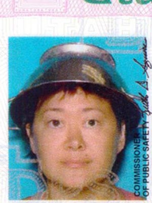 Asia Lemmon, whose legal name appears on her driver's license as Jessica Steinhauser, is shown wearing a metal colander on her head on her Utah driver's license.