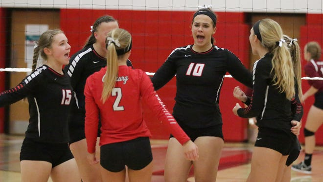 Oostburg players celebrate a point earned against Elkhart Lake-Glenbeulah Tuesday August 29, 2017, in Oostburg, Wis.