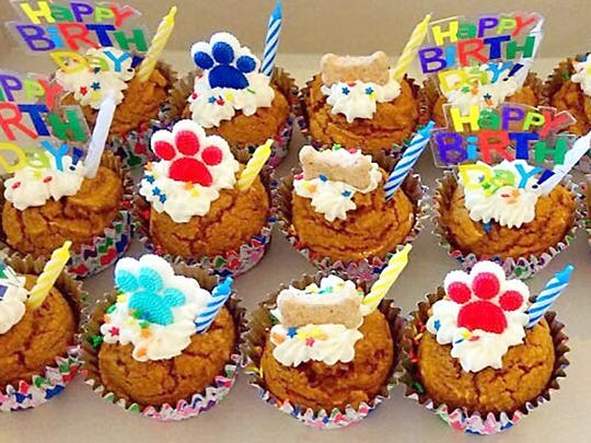 Celebrate a milestone with your best friend with a party! Include a cake or some of Tina Wheeler's decorated pupcakes.