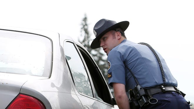 Oregon State Police Senior Trooper Cameron Bailey pulls over a driver for speeding while patrolling for distracted drivers along a section of Interstate 5 in an unmarked patrol vehicle on Tuesday, April 5, 2016, during a ride along. April is National Distracted Driver Awareness Month.
