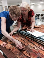 """In this file photo, Frances Brakeen (left) and Carolyn Miller prepare a design for the """"Quilting in the Falls"""" show. This year's event will be held Sept. 21-22 at MPEC."""