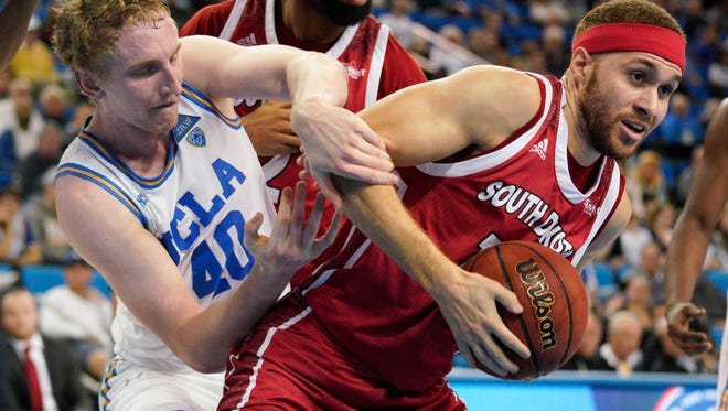 South Dakota Coyotes forward Trey Burch-Manning (12) and UCLA Bruins center Thomas Welsh (40) battle for the rebound during the second half at Pauley Pavilion. Mandatory Credit: Kelvin Kuo-USA TODAY Sports