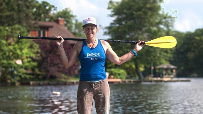 Margo Pellegrino floats her boat near her home at Upper Aetna Lake in Medford Lakes. Pellegrino loves stand-up paddleboarding.