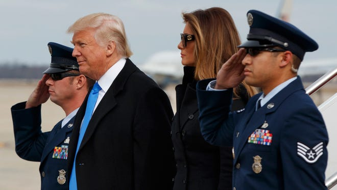 President-elect Donald Trump and his wife Melania Trump arrive at Andrews Air Force Base, Md., Thursday, Jan. 19, 2017, ahead of Friday's inauguration.