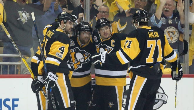 The Penguins celebrate a power play goal by right wing Phil Kessel, left center, against the Blue Jackets during the first period in Game 5 of their first-round playoff series in Pittsburgh.