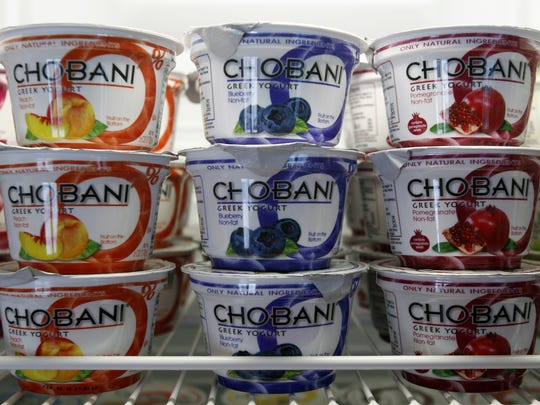 Cups of Chobani Greek Yogurt line the shelves in the dairy case.