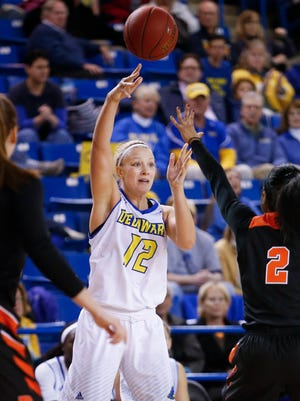 Delaware's Hannah Jardine throws a pass over Princeton's Taylor Brown in the second half of the Blue Hens' 66-62 win at the Bob Carpenter Center Wednesday.