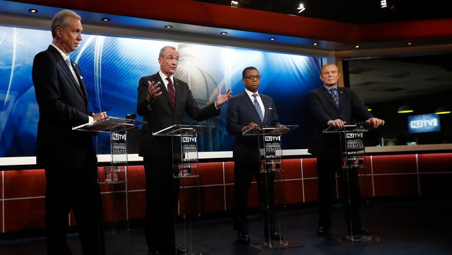 Candidates, from left, Assemblyman John Wisniewski, Phil Murphy, Jim Johnson and Sen. Ray Lesniak attend a Democratic gubernatorial primary debate, Thursday, May 11, 2017, in Newark.