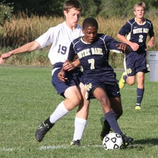 Rocco Coulibaly of Elmira Notre Dame controls the ball as Ezra Evans of Watkins Glen defends Tuesday during the Crusaders' 6-0 victory at Watkins Glen.
