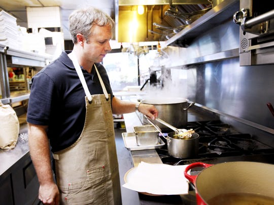 The Market Place executive chef and owner William Dissen making a tempura-fried day lily blossom in 2016.