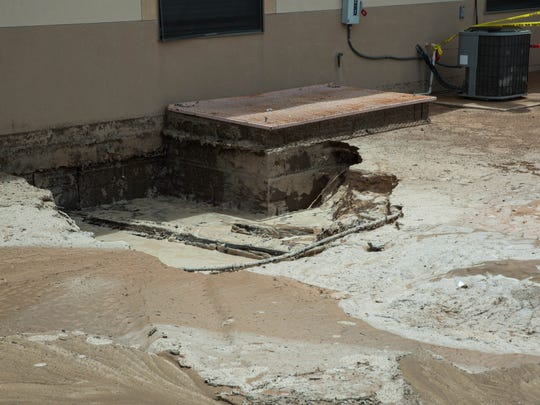 Heavy rains Sunday night in Hatch created a sinkhole outside of one of the buildings at the Valle Verde Apartments. Monday July 24, 2017.