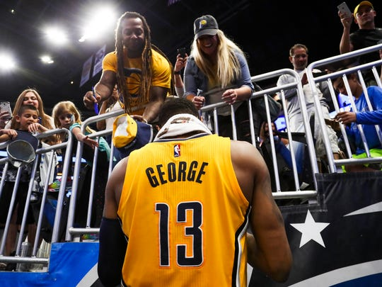 Apr 8, 2017; Orlando, FL, USA; Indiana Pacers forward Paul George (13) signs autographs for fans after a game against the Orlando Magic at Amway Center. The Pacers won 127-112. Mandatory Credit: Logan Bowles-USA TODAY Sports