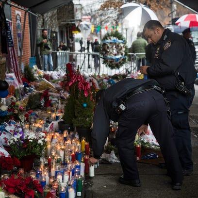 Rafael Ramos, left, and Wenjian Liu, right, were killed on Dec. 20, 2014, as they sat in their patrol car on a Brooklyn street.