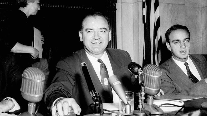 Sen. Joe McCarthy, R-Wis., presides at a hearing of the Senate Investigations Subcommittee, in Washington, in this March 10, 1954 file photo. Seated at right is committee counsel Roy Cohn.