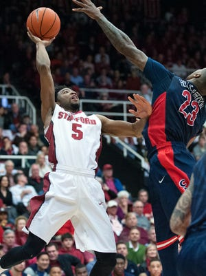 Jan 22, 2015; Stanford, Calif.; Stanford Cardinal guard Chasson Randle attempts a shot over Arizona Wildcats forward Rondae Hollis-Jefferson during the first half at Maples Pavilion.