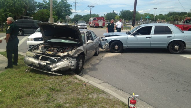 A vehicle and deputy cruiser crash in Fort Myers on Thursday.