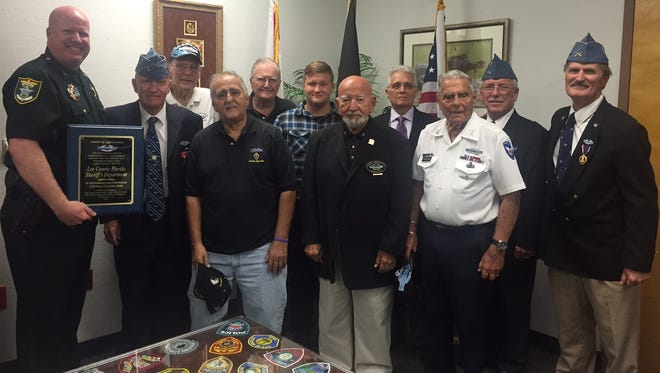 Front: Col. Tom Ellegood with the Lee County Sheriff's Dept., Earl Kennedy, Gene Olney, Dan Sankoff, Bert Kurland, Jack Wagner.  Back: Dick Williams, Jim Dingeman, Joseph Kennedy, Nick Hubbel, Dan Bernard.