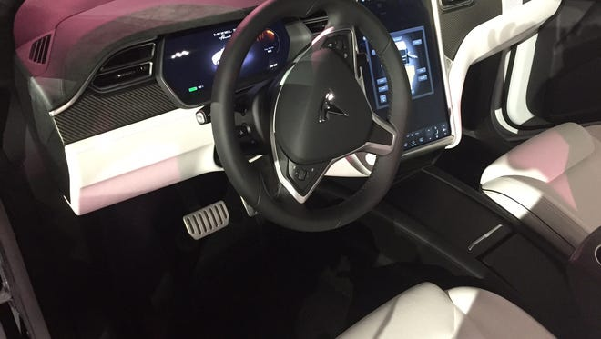 Tesla unveiled its long-awaited electric crossover Tuesday night, a gull-winged beauty that it is banking on shaking up the luxury vehicle market. Here is a shot of the interior.