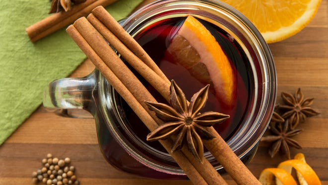Mulled wine has been a favorite holiday tradition in British and German homes for centuries. It is typically concocted using a spicy or fruit-forward red wine, along with a variety of mulling spices including, from top down at right, coriander, cinnamon and cloves.
