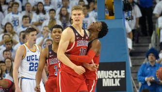 January 21, 2017; Los Angeles, CA, USA; Arizona Wildcats guard Kobi Simmons (2) reacts after forward Lauri Markkanen (10) scores a basket and draws the foul against the UCLA Bruins during the second half at Pauley Pavilion. Mandatory Credit: Gary A. Vasquez-USA TODAY Sports