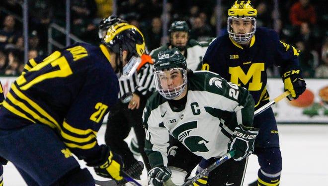 MSU's Michael Ferrantino moves in on Michigan's Nicholas Boka Janauary 8, 2016.  MSU lost 9-2 at Munn Arena.