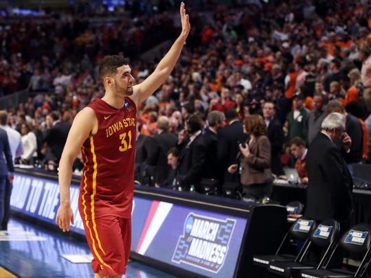 Iowa State's Georges Niang waves to the fans after a loss in the regional semifinals of the men's NCAA Tournament, in Chicago Friday, March 25, 2016.
