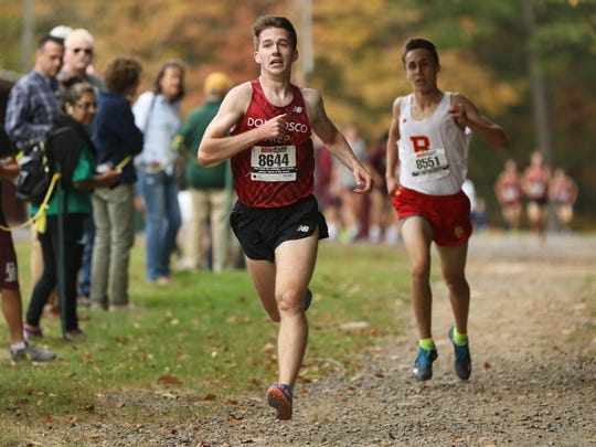 Patrick Donnelly, of Don Bosco Prep, captures first place in the United Division, just before Braedon Fiume, of Bergen Catholic, at Darlington County Park in Mahwah, Friday, October 13, 2017.