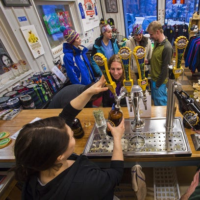 Customers have their growlers filled at the Drop-In