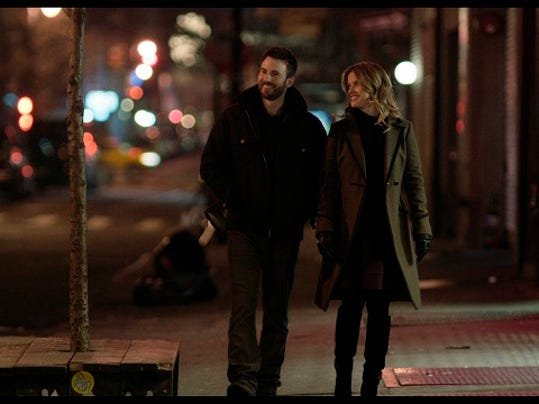 """This photo provided by RADiUS shows, Chris Evans, left, as Nick Vaughan, and Alice Eve, as Brooke Dalton, in a scene from """"Before We Go."""" The film is Evans' directorial debut. It opens in theaters on Friday, Sept. 4, 2015. (RADiUS via AP)"""