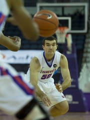 University of Evansville's Blake Simmons (50) makes