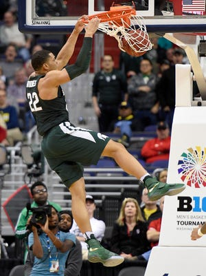 Michigan State guard Miles Bridges (22) dunks during the second half MSU's 63-58 loss in the Big Ten tournament Friday in Washington.