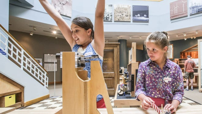 "Eureka! Caitlin Schicker (left), and Liberty Morris play in the patent office of the new ""Create.Connect"" exhibit combining history and science at Conner Prairie. A $2.3 million National Science Foundation grant helped fund the space."