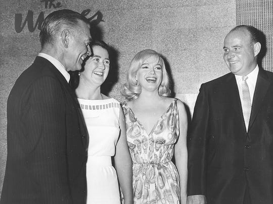 "Clark Gable, left, Gloria Mapes Walker, Marilyn Monroe and Charles Mapes Jr. share a laugh during a 1960 party at the Mapes Hotel. Gable and Monroe were in the area to film ""The Misfits.''"