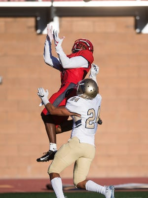 Current Kent State wide receiver Isaiah Wooden is pictured catching a touchdown pass while playing for Dixie State University in Utah during the 2018 season. Wooden led the Golden Flashes with 83 yards receiving in last Tuesday's 62-24 victory at Bowling Green.