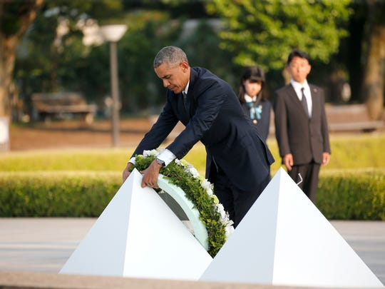 President Obama lays a wreath at Hiroshima Peace Memorial Park on May 27, 2016.
