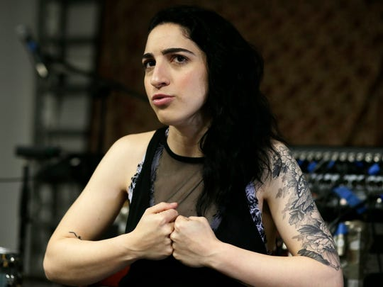 In this Tuesday, Jan. 31, 2017 photo, Emily Estefan talks during an interview after band practice in the garage of her late grandparent's mansion in Miami Beach, Fla.