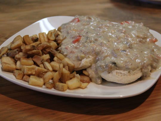 Krewe du Soul's biscuits and gravy arrive on housemade biscuits, smothered in Southern sausage gravy and served with home fries.