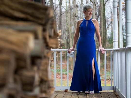 Anna Touchard wears her Nightway royal blue sheath gown embellished with lace inset and sequins with silver heels by Rialto.