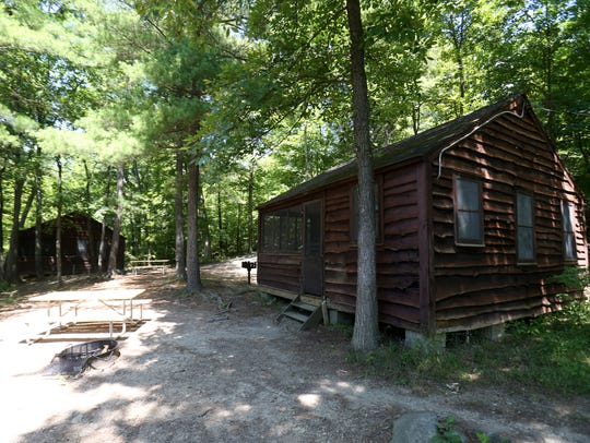 Cabins available for rent at Mills Norrie State Park in Staatsburg are pictured on July 10.