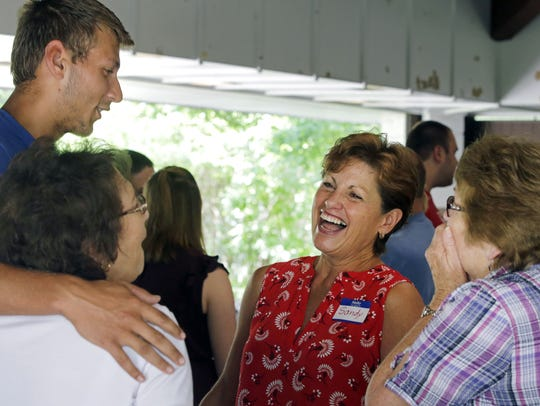 Sandy Phillips, center, shares a laugh with Maria Griesbach,