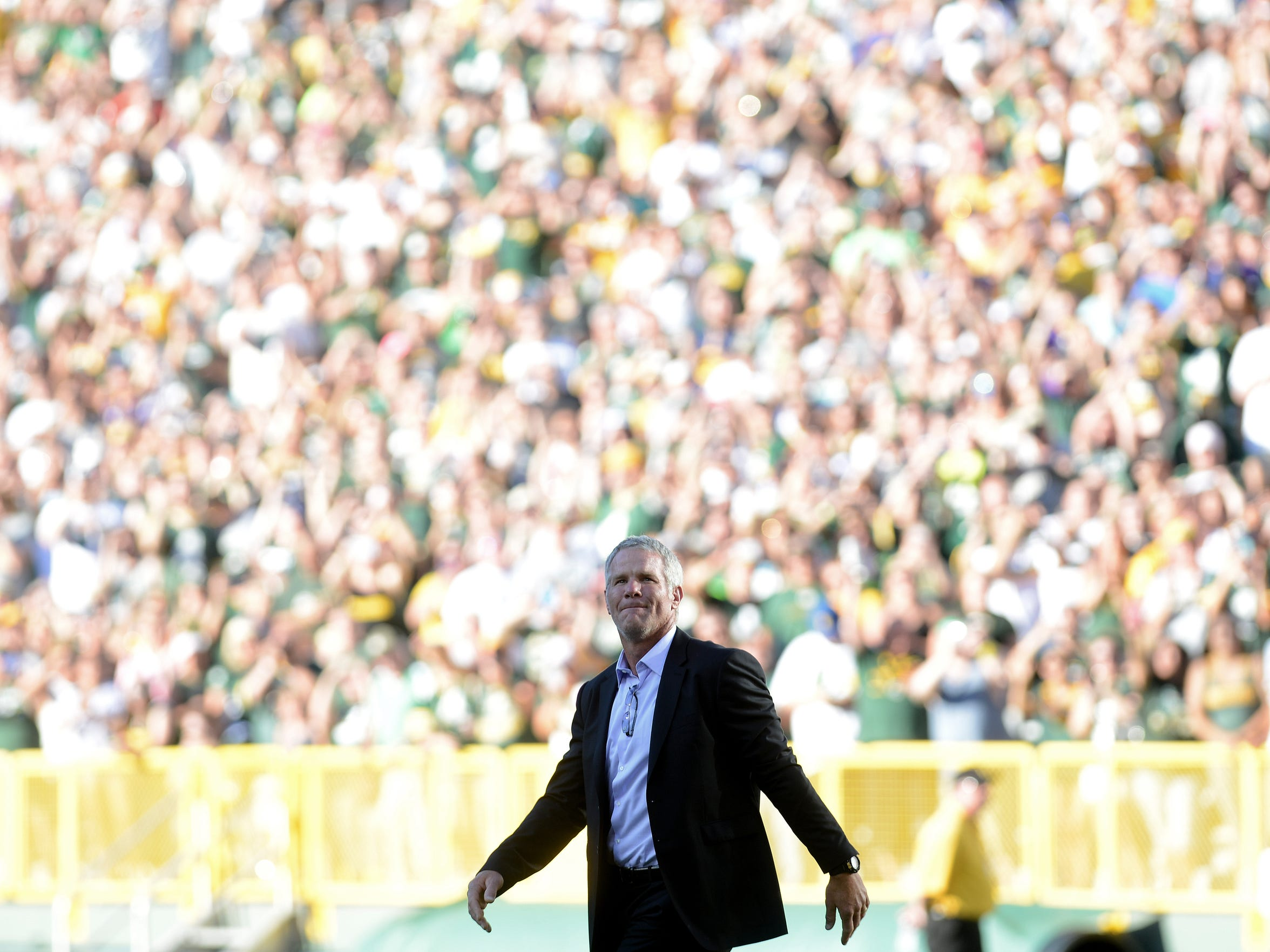 Brett Favre looks out at a sold-out crowd in the bowl of Lambeau Field during his induction into the Packer Hall of Fame.