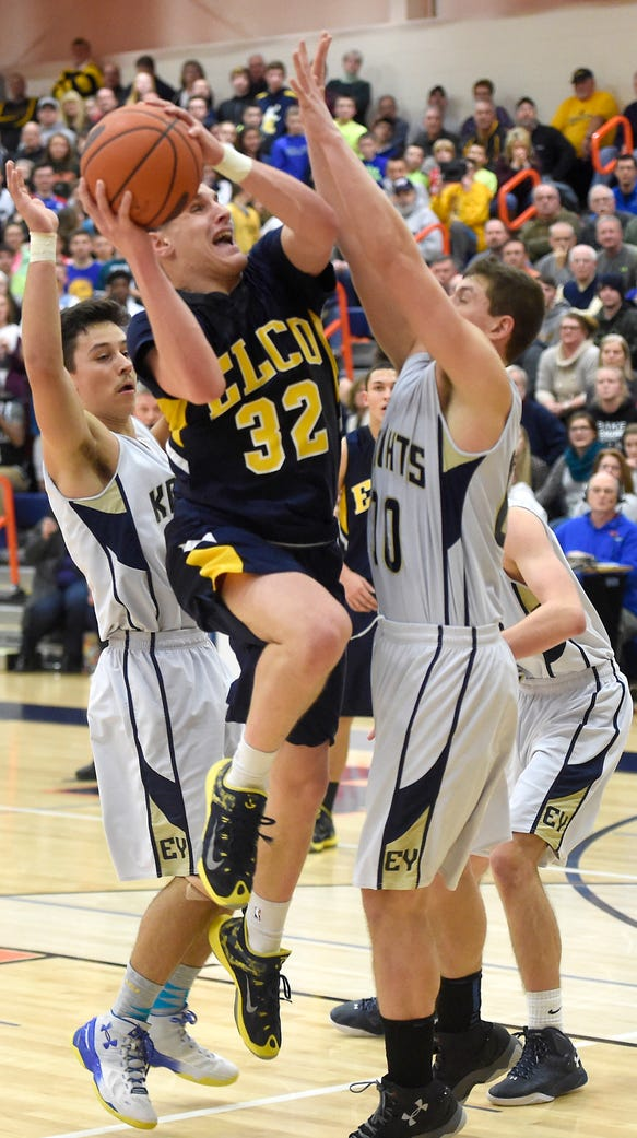 Elco's Colton Lawrence drives between Knight defenders